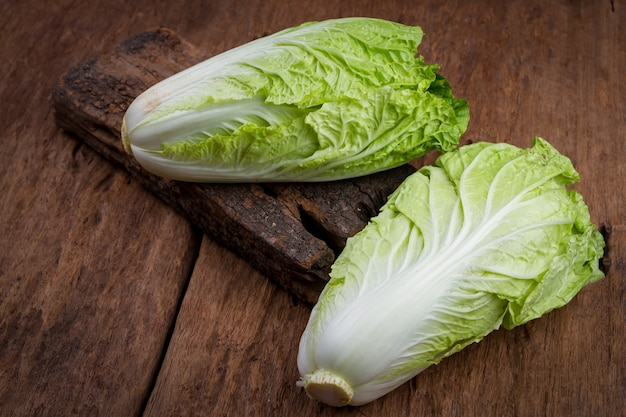 Fresh chinese cabbage on old wooden table background