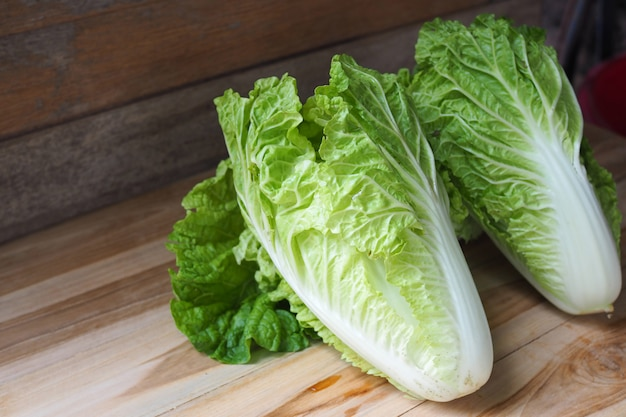 Fresh chinese cabbage on wooden table background