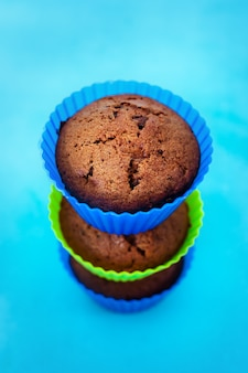 Fresh chocolate muffins in silicone holders