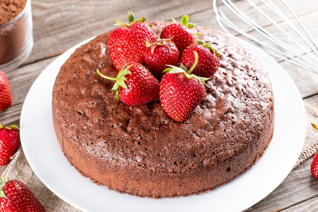 Fresh chocolate sponge cake with strawberry. chiffon biscuit for cake, selective focus