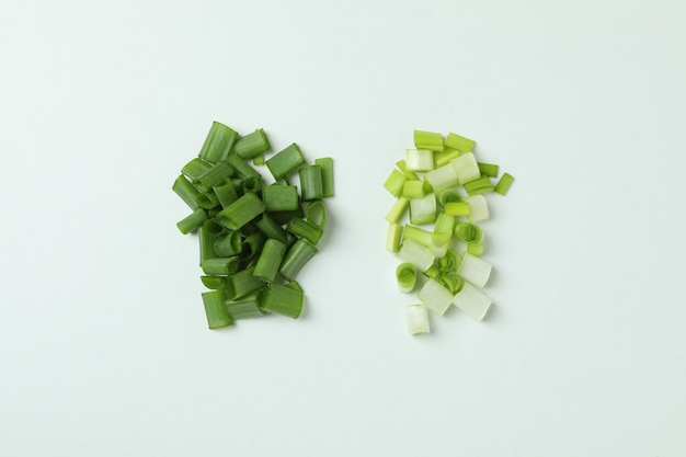Fresh chopped green onion on white