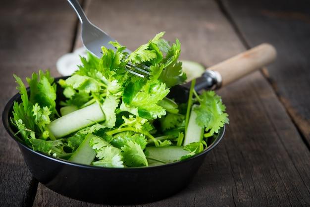 Fresh cilantro salad, coriander with cucumber salad. healthy food concept.