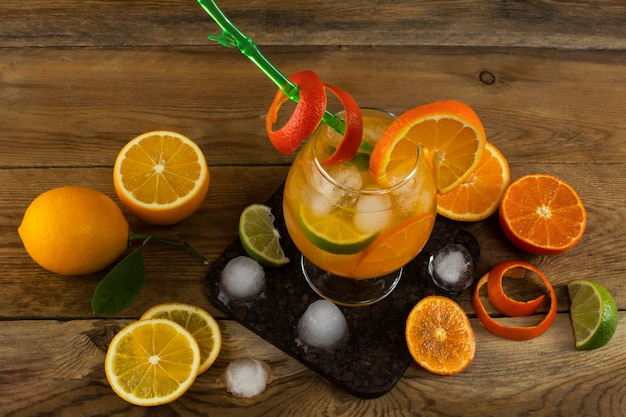 Fresh citrus drink on wooden table