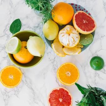 Fresh citrus fruits on marble