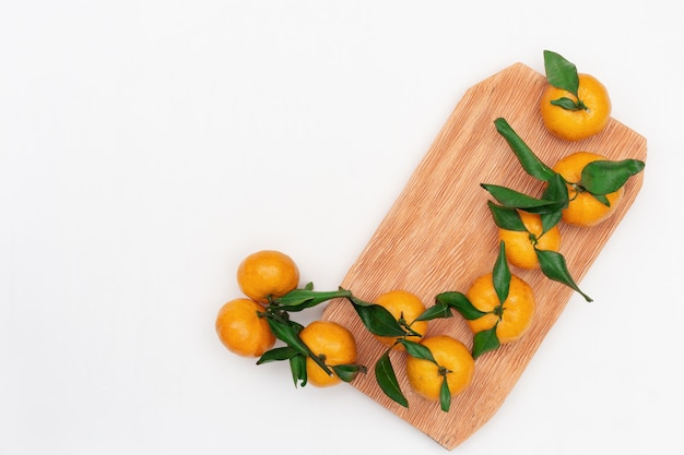 Fresh citrus fruits tangerine or mandarin on white background with copy space