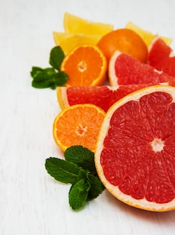 Fresh citrus fruits with green mint