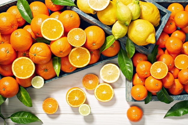 Fresh citrus fruits on wooden table