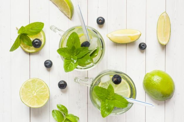 Fresh citrus lemonade in a glass of lime berry mint blueberries