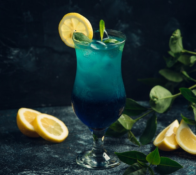 Fresh cocktail with curacao and lemon