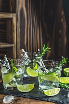 Fresh cocktail with lime, ice and rosemary