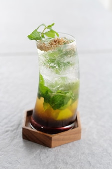Fresh cocktail with orange and flavoured syrup