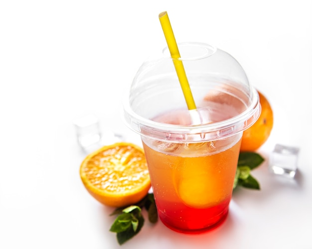 Fresh cocktail with orange and ice. alcoholic, non-alcoholic drink-beverage on a white surface