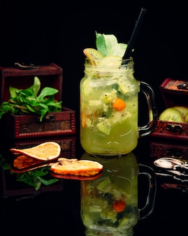 Fresh cocktail with pineapple and kiwi