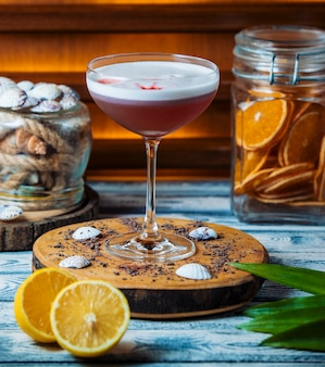 Fresh cocktail on wooden board