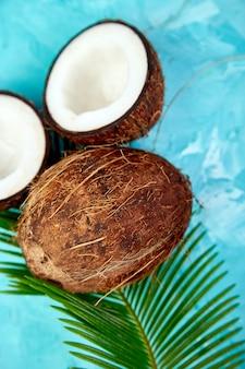 Fresh coconut on blue. flat lay.