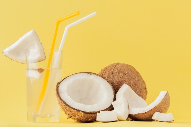 Fresh coconut cocktail with a straws