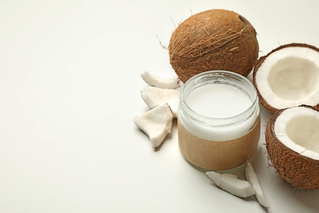 Fresh coconut and coconut milk on white background