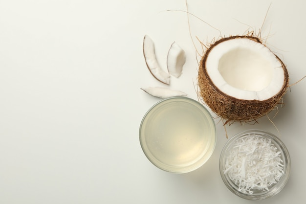 Fresh coconut and coconut milk on white