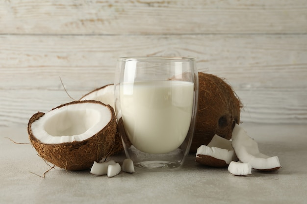 Fresh coconut and coconut milk on wooden