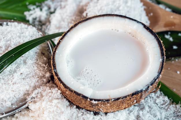 Fresh coconut milk in coconut bowl close up