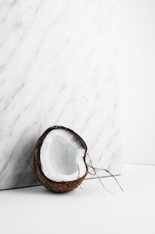 Fresh coconut shell against marble backdrop