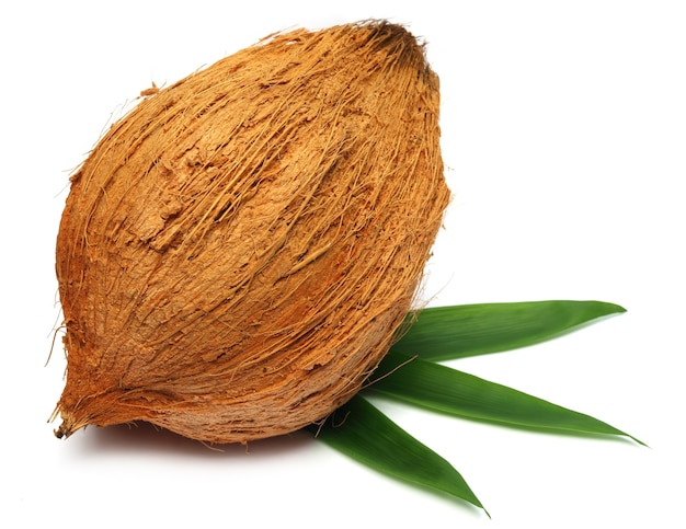 Fresh coconut with leaves over white background