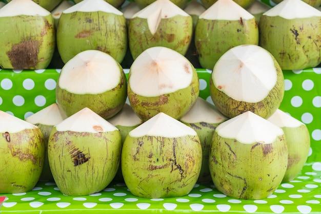 Fresh coconuts on shelf