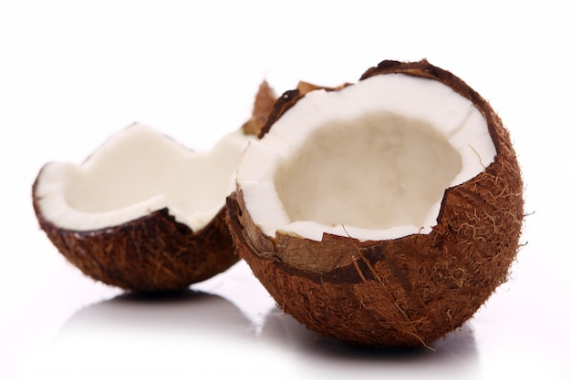 Fresh coconuts on white surface