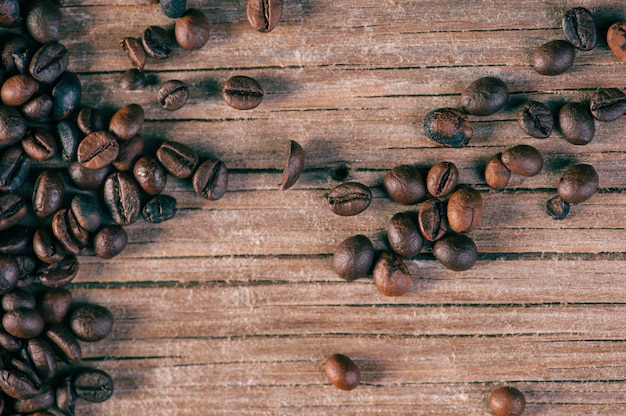 Fresh coffee beans on wood background