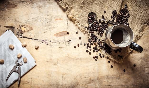 Fresh coffee in the jug and newspaper.