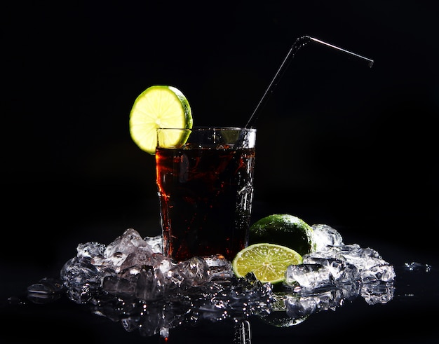 Fresh cola drink with green lime