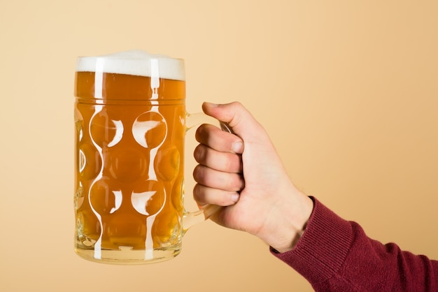 Fresh cold beer in glass in hand leisure drinks degustation people and holidays concept man hand