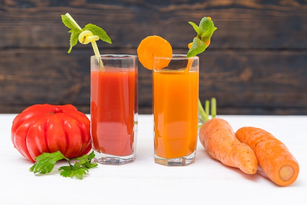 Fresh colorful healthy tomato and carrot smoothies