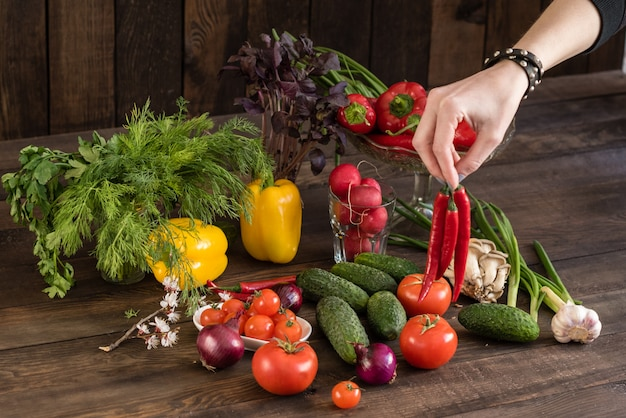 Fresh colorful vegetables from a kitchen garden on a dark wooden background