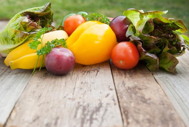 Fresh colorful vegetables ingredients fo vegan and healthy cookingsalad making on rustic , top view, . copyspace.