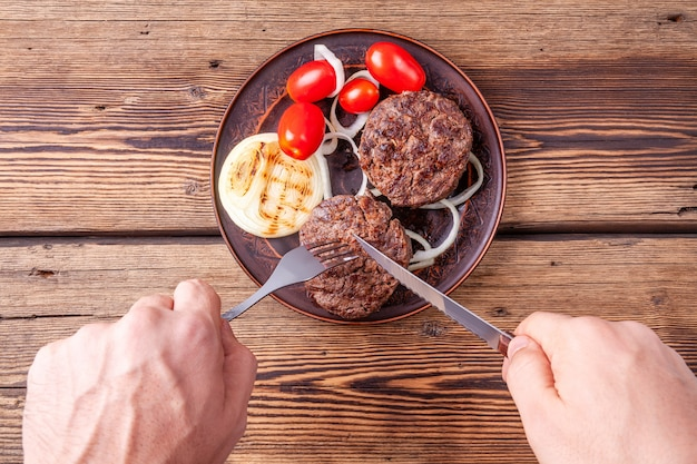 Fresh cooked burger meat with vegetables