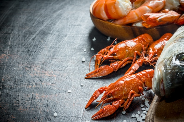 Fresh cooked crayfish on dark rustic table