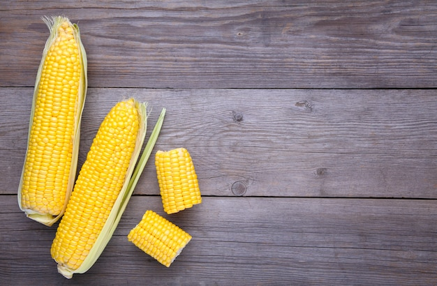 Fresh corn on a grey wooden background