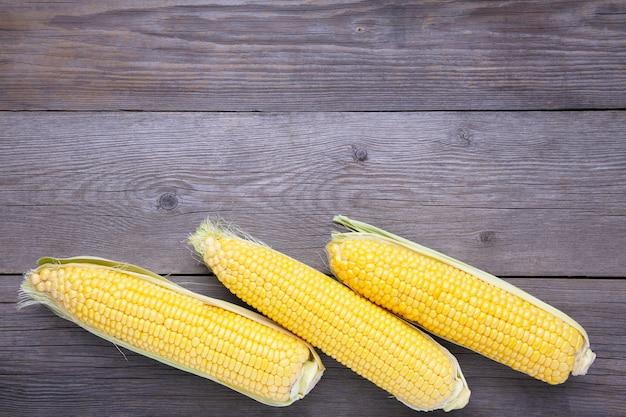Fresh corn on a grey wooden