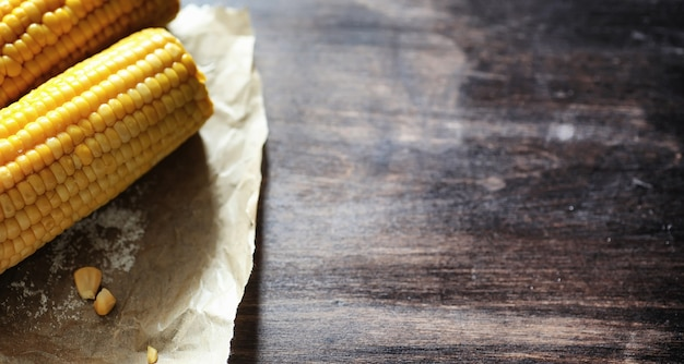 Fresh corn. natural food from corn cob with salt. rural mexican food. healthy food. boiled and fried corn cobs on wooden table are served with salt.