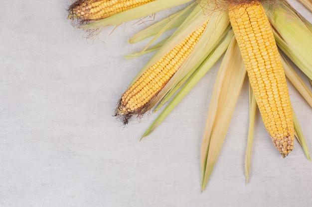 Fresh corns on cobs on white.