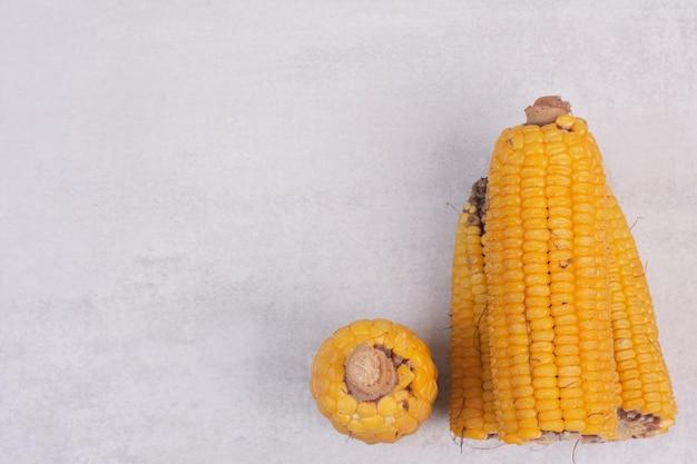 Fresh corns on white table.
