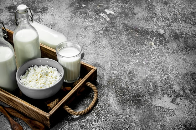 Fresh cottage cheese in a bowl on rustic table.