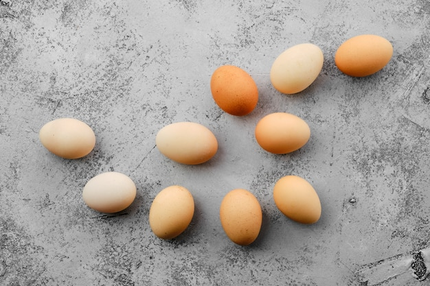 Fresh country eggs scattered on table top view