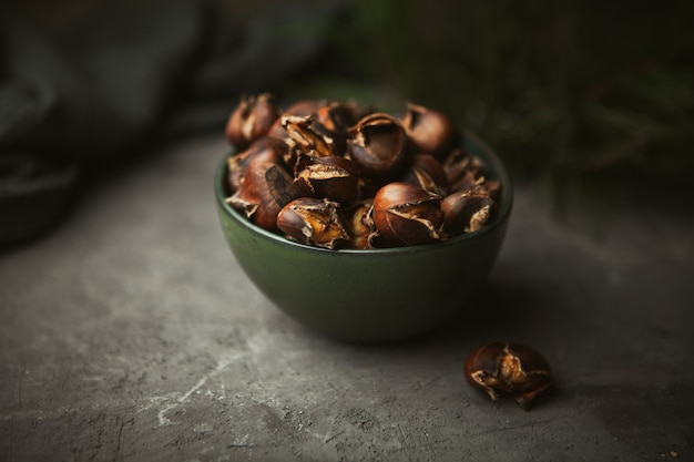Fresh cracked roasted chestnuts in the bowl