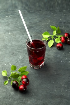 Fresh cranberry juice with a straw