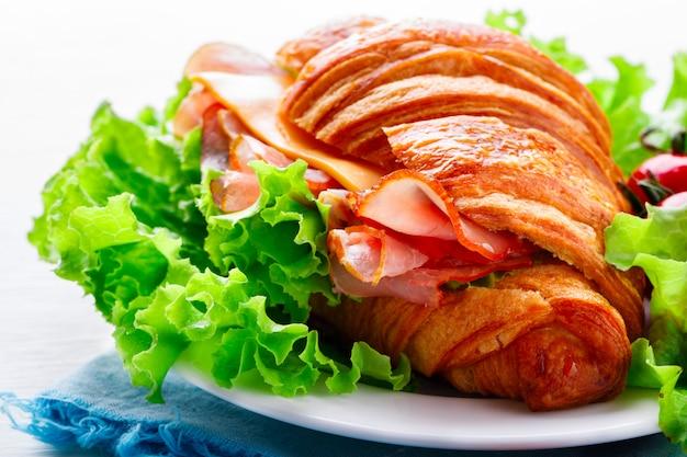 Fresh croissant sandwich with  ham, cheese