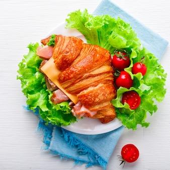 Fresh croissant sandwich with ham.summer snack