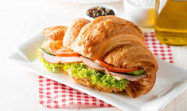 Fresh croissant with ham.