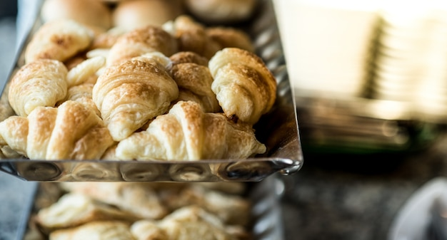 Fresh croissants in a container.